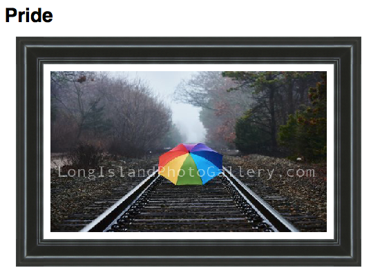 Photographer: Ruben Cosme Description: A rainbow colored umbrella sitting on the train tracks on a foggy day.