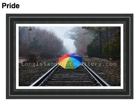 Photographer: Ruben Cosme Description: A rainbow colored umbrella sitting on the train tracks on a foggy day.